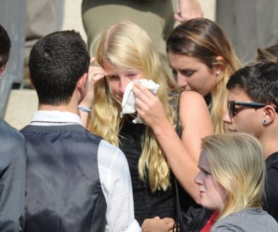 Mourners during the funeral Mass for Bart Palosz, who committed suicide after attending the first day of classes as a sophomore at Greenwich High school