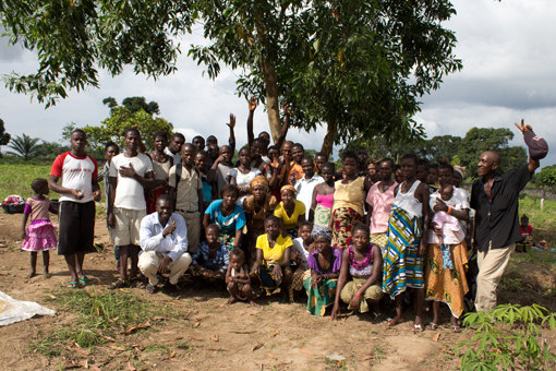 Everyone involved in the farm project pose together in a group photo.