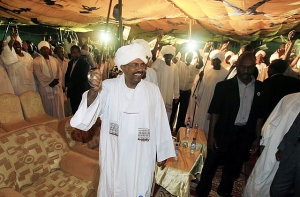 Sudan's President Omar al-Bashir waves to supporters at the NCP Headquarters in Khartoum on April 26, 2010. © 2010 Reuters