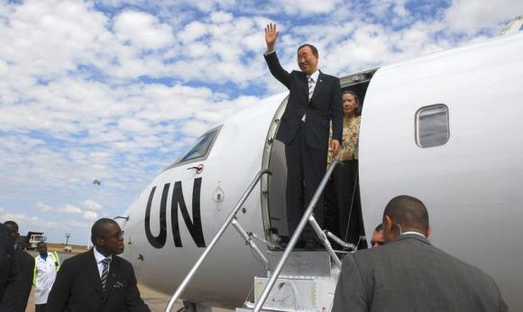 U.N. Secretary General Ban Ki-moon waves as he arrives at the Kamuzu International Airport in the Malawi capital Lilongwe May 29, 2010, on his mission to pursuade Malawi's president to take a stand on Malawi homosexuals who were imprisoned for 14 years. REUTERS/Eldson Chagara.