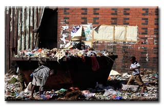 Children play in a in refuse dump in Harare, Zimbabwe's capital. © 2013 Reuters