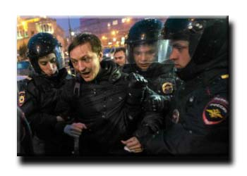 Police detain an activist during a unsanctioned protest rally against recent developments in Russian-Ukrainian relations, in front of the Russian Ministry of Defence in central Moscow on March 4, 2014.