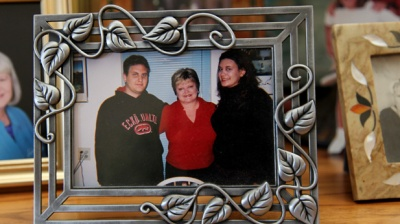 Daniel Moreno photographed with his mother and sister.