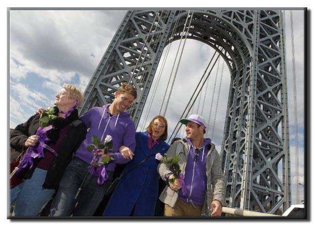 Jane Clementi, second from right, the mother of Tyler Clementi, holds onto the arms of Ronnie Kroell, left, and Elliot London, as they walk across the George Washington Bridge in honer of Tyler's memory and to bring attention to bullying awareness in a 2014 file photo. (Robert Sciarrino | The Star-Ledger) (Robert Sciarrino/The Star-Ledger)